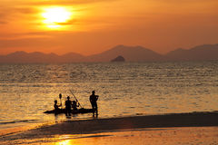 Silhouetted of travellers in the beach at Krabi, Thailand. Royalty Free Stock Images