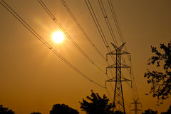 Silhouetted view of electric pole under sunshine Royalty Free Stock Photography