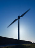 Silhouetted Wind Turbine Stock Photography
