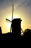 Silhouetted windmill Royalty Free Stock Image