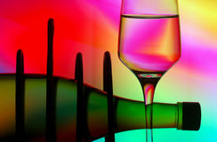 Silhouetted wine bottle & glass Royalty Free Stock Images