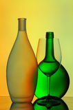 Silhouetted wine glass and bottles Royalty Free Stock Images