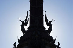 Silhouetted winged victories at Columbus monument in Barcelona. Silhouette of winged victories, detail on pedestal of Columbus monument in Barcelona Stock Image