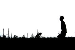 Silhouetted working man Royalty Free Stock Image