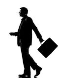 Silhouetteer mens het lopen profiel met aktentas stock foto