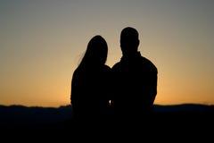 silhouettekvinna för 2 man Royaltyfri Fotografi