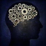Silhouettemänniskan med utrustar för hjärnor Arkivbild