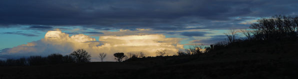 Silhouetten en Wolken Stock Foto