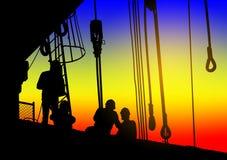 Silhouetten van arbeiders bij een bouwwerf royalty-vrije stock fotografie