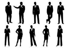 Silhouetten van bedrijfsmannen en vrouwen Stock Foto