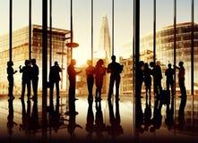 Silhouetten van Bedrijfsmensen Stock Foto's