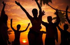 Silhouetten van Diverse Multi-etnische Mensen Partying stock foto