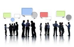 Silhouetten van het Bedrijfsmensen Bespreken Stock Fotografie