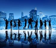 Silhouetten van het Bedrijfsmensen Springen Stock Afbeeldingen