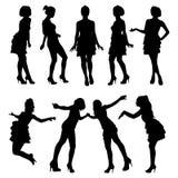 Silhouetten van jonge meisjes Stock Foto's