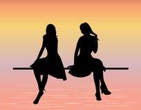 Silhouetten van jonge vrouwen Royalty-vrije Stock Foto's