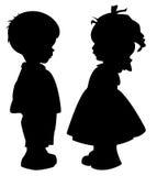 Silhouetten van kinderen Stock Afbeeldingen