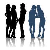 Silhouetten van meisjes die aan elkaar spreken Royalty-vrije Stock Fotografie