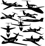 Silhouetten van privé jets Stock Fotografie