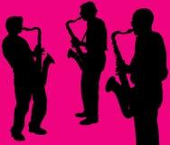 Silhouetten van saxofoonspelers Stock Foto