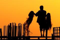 Silhouetten van Vissers Royalty-vrije Stock Afbeeldingen