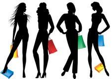 Silhouetten van vrouwen met het winkelen. Royalty-vrije Stock Foto's