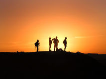 silhouettes заход солнца Стоковое Изображение