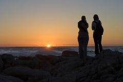 silhouettes заход солнца Стоковые Фотографии RF