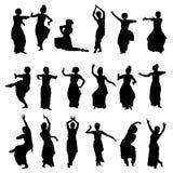 Silhouettes индийские танцоры Стоковые Изображения
