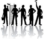 silhouettes работники Стоковая Фотография