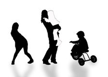 Silhouettes. Full-grown with three children  on white background Royalty Free Stock Photos