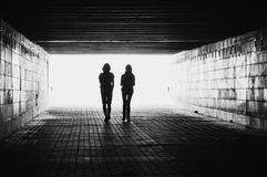 Silhouettes. A silhouette of couple in a tunnel Royalty Free Stock Images