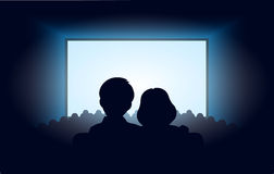 Silhouettes A Loving Couple At Movie Theater Royalty Free Stock Photography
