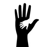Silhouettes of adult and childrens hands Stock Photos