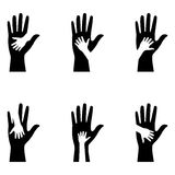 Silhouettes of adult and childrens hands Royalty Free Stock Images