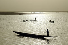 Silhouettes of African fishermen Royalty Free Stock Image