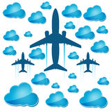 Silhouettes of airplanes with blue clouds Stock Images