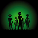 Silhouettes of aliens Stock Images