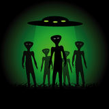 Silhouettes of aliens. And spaceship on the green background Royalty Free Stock Images