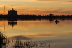 Silhouettes along the River. Fire in the sky along the Sacramento River California stock photos