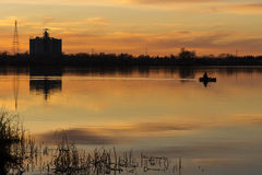 Silhouettes along the River Stock Photos