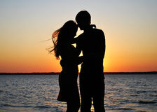 Silhouettes of amorous couple Stock Photos