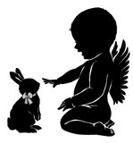 Silhouettes angel baby and  Easter Bunny. Silhouettes angel baby and `Easter Bunny Royalty Free Stock Photos