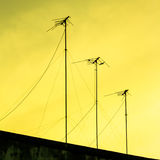 Silhouettes of antennas with sunset Stock Photography