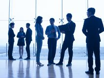 Silhouettes of asian business people royalty free stock image