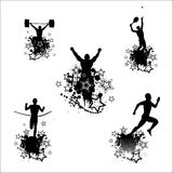 Silhouettes of the athletes Royalty Free Stock Photo