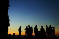 Silhouettes på solnedgången Fotografering för Bildbyråer