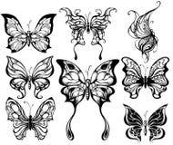 Silhouettes av exotiska fjärilar Royaltyfria Bilder