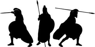 Silhouettes av forntida krigare Royaltyfri Foto