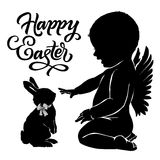 Silhouettes baby angel and bunny Happy Easter. Silhouettes baby angel and bunny with `Happy Easter` text Royalty Free Stock Photo